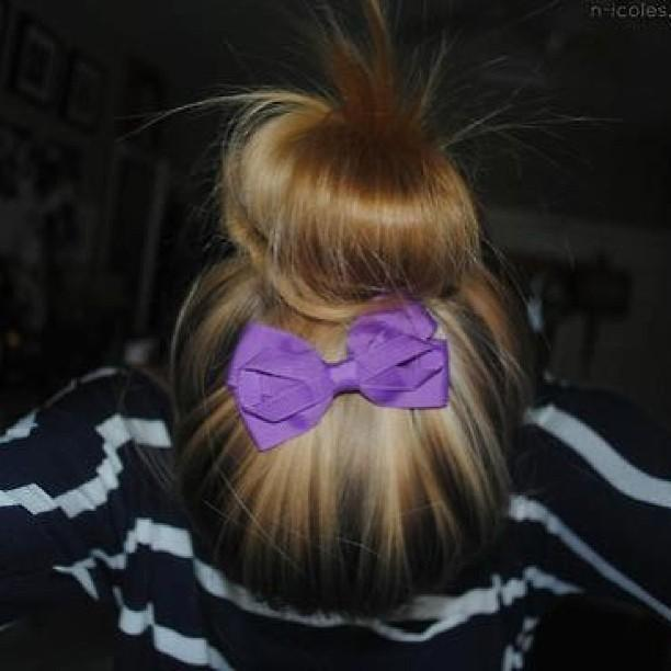 updo with purple bow