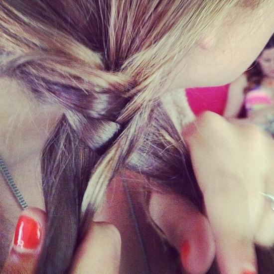 Learning how to make a fishtail braid